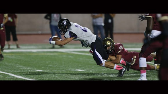 Franklin running back Seth Dominguez stretches to reach the end zone despite the efforts of El Dorado's Salvador Avila last season at the SAC.