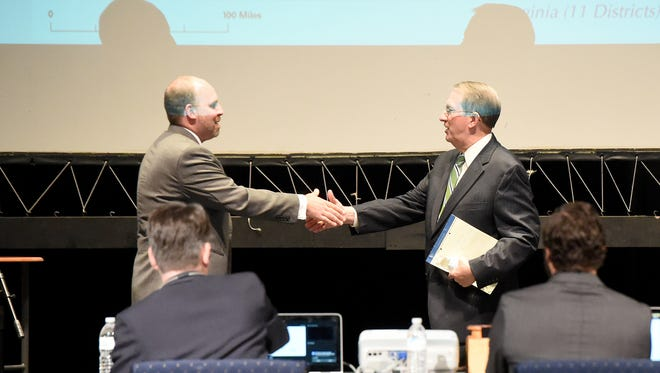 Democratic challenger Kai Degner and U.S. Rep. Bob Goodlatte meet center stage and shake hands at the end of their Virginia 6th congressional district debate held at E.C. Glass High School in Lynchburg on Monday, Oct. 17, 2016. The event was co-sponsored by the school and the Lynchburg Regional Business Alliance.