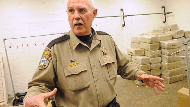 File photo of former Augusta County Sheriff Randy Fisher talking about a marijuana seizure in 2010 from inside the evidence room of the Augusta County Sheriff's Office in Verona.
