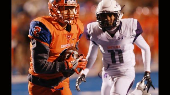 Canutillo receiver Joseph Paz snags a long pass for