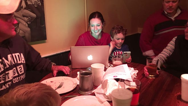 Anne Fitzgerald of Staunton watch results come in live as her 4-year-old son, Sean Fitzgerald, plays Pokemon Go at a Republican election night watch party held at The Bistro in Staunton on Tuesday, Nov. 8, 2016.