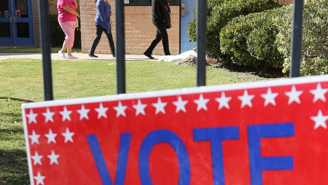 Voters head into Cedar Grove Elementary School to cast their votes Tuesday.