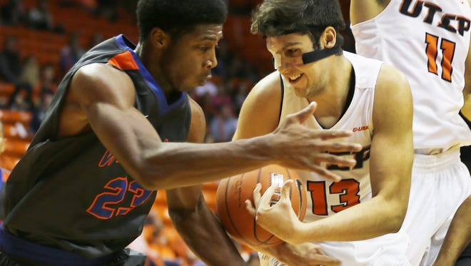 UTEP's Deon Barrett, right, and Louisiana College's Steve Evans scramble to secure a loose ball Saturday.
