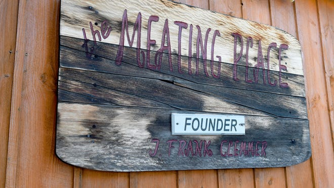 """A sign on the side of the building not only identifies the business as being """"The Meating Place,"""" but also identifies the founder of the business as J. Frank Clemmer."""