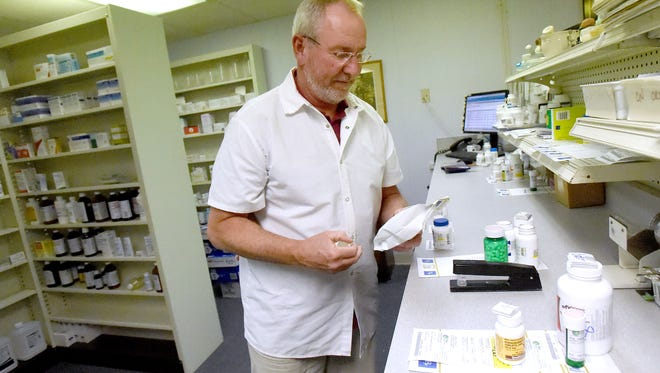 Pharmacist Danny Ray has a clean history both as a pharmacist and as owner of Ray's Health Mart Pharmacy. He bags a medication just filled at the pharmacy in Staunton on Nov. 29.