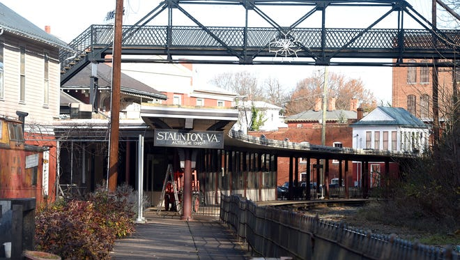 A sign marks both Staunton and its altitude of 1395 feet at the train station near the Sears Hill bridge in downtown Staunton. Photograph taken on Monday, Dec. 5, 2016.