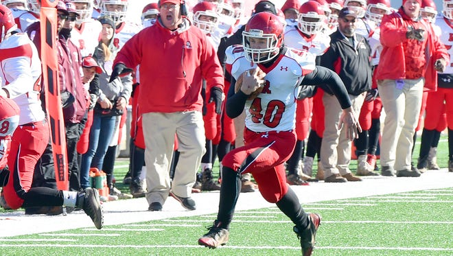 Riverheads' Harrison Schaefer breaks away with the ball and runs the ball towards the end zone for a touchdown during the Group 1A state championship football game played in Salem on Saturday, Dec. 10, 2016.