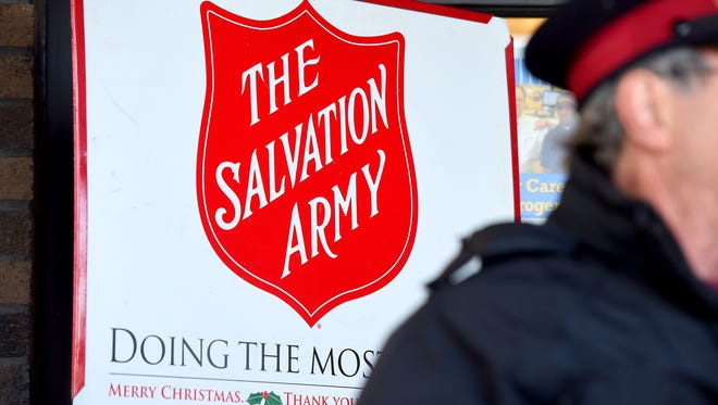 "The sign over Darrell Jone's red kettle. He is proud to be a ""soldier"" in the Salvation Army."