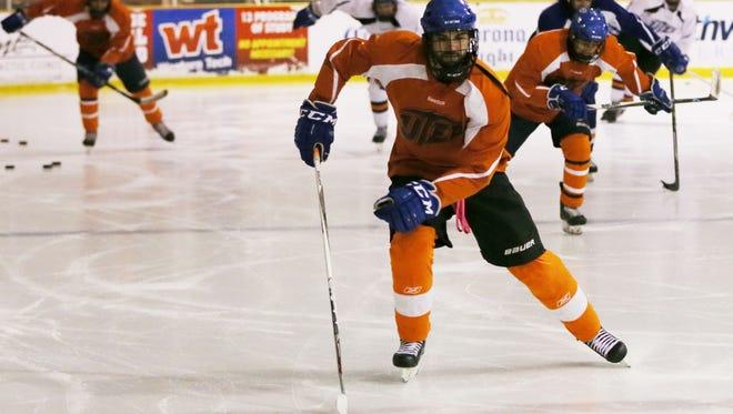 UTEP hockey team members go through drills Thursday.