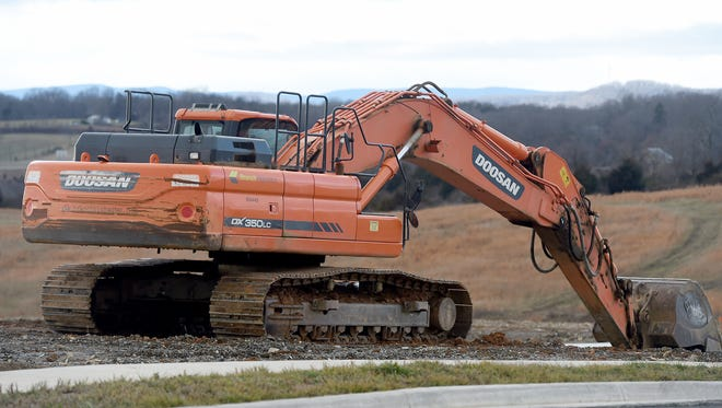 An excavator being used in construction at Myers Corner in Fishersville on Tuesday, Jan. 24, 2017.