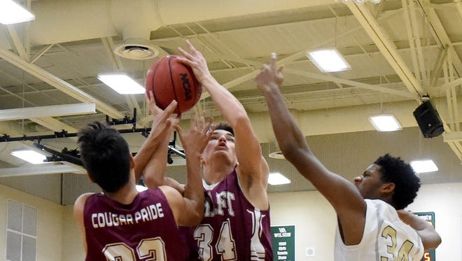 Stuarts Draft's Antonio Ruiz-Haynes and Kasey Branch battle Wilson Memorial's Zay Brown for the rebound during a game played in Fishersville on Friday, Jan. 27, 2017.