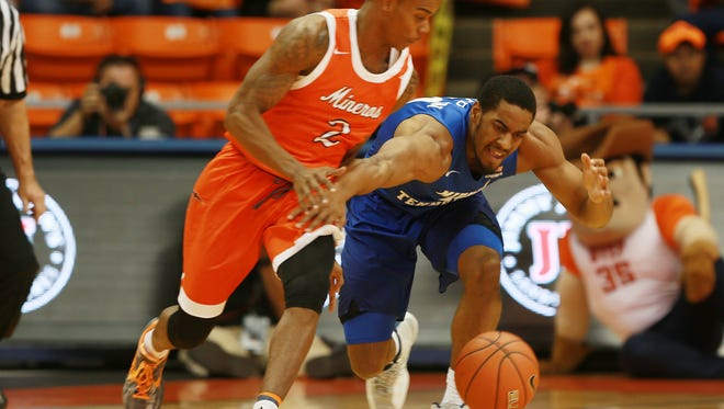 Middle Tennessee's Edward Simpson, right, attempts to steal the ball from UTEP's Omega Harris during the first half Saturday Feb. 4, 2017 in El Paso, Texas.