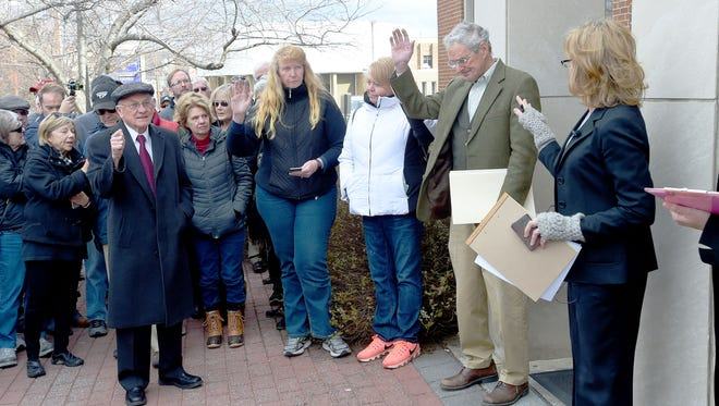 Potential bidders are asked to raise their hands at the start of the auction of the Waynesboro Country Club, held on the steps of the courthouse in Waynesboro on Wednesday, Feb. 15, 2017. Kenneth Bradley of Waynesboro won the auction with a bid of $891,000.