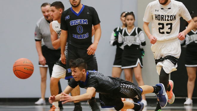 Bowie's Andy Valdez went horizontal to reach and then pass the ball to a teammate to start a fastbreak against Horizon Monday at the Horizon gym. The hustle play led to a Bowie basket.