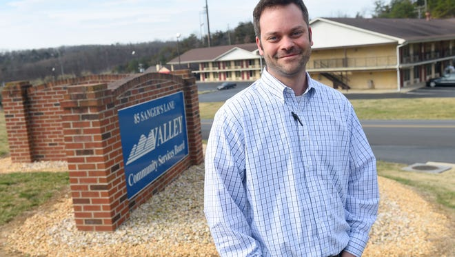 Dustin Wright works as community liaison with administrative outreach at Valley Community Services Board. Wright is photographed outside their offices in Staunton on Tuesday, Feb. 28, 2017.