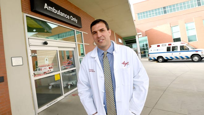 Dr. Adam Rochman serves as medical director of the emergency department at Augusta Health. Rochman is photographed outside the ambulance entrance at the hospital on Tuesday, Feb. 28, 2017.