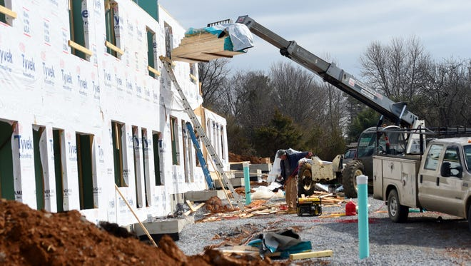 Construction continues on townhouses being built by Staunton Apartments LLC alongside Seth Drive in Staunton on Tuesday, March 21, 2017.