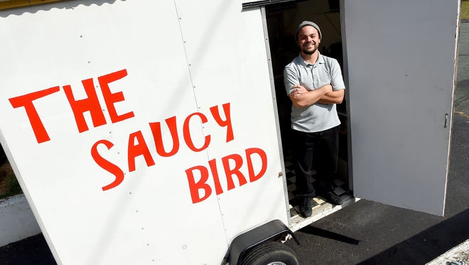 Alex Glenn is owner and chef of The Saucy Bird. He stands with his food truck in Staunton on Tuesday, March 21, 2017.