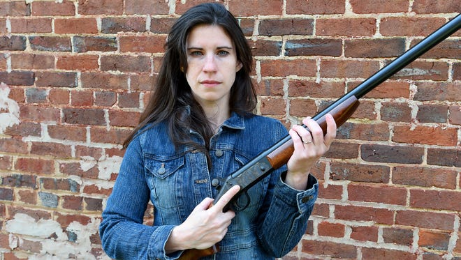 Erin Murphy holds her 12 gauge New England firearms shotgun, circa 1930s, outside her home in Staunton on March 24, 2017.