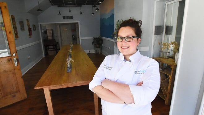Chef and owner Caitie Maharg stands within Blue Oregano, located at 403 West Main Street in her hometown of Waynesboro, Va., on Wednesday, May 3, 2017. The business offers catering, pop-up dinners, classes and private dinners with their first pop-up dinner planned for June 3.