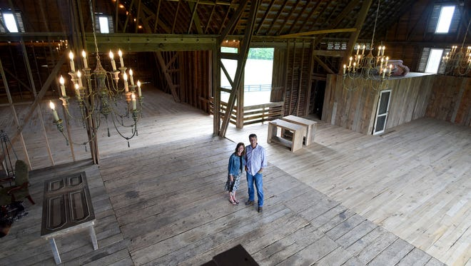 Mark and Debbie Battle stand within the heart of their barn at Red August Farm, located at 1620 Barrenridge Road, Waynesboro, Va., on May 4, 2017. The couple have worked to transformed their farm into a wedding venue.