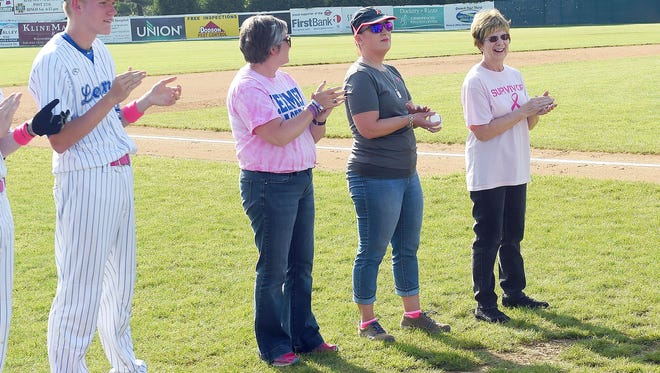 Cancer survivors Tracy Morris, Lara Steelman and Bonnie Goff applaud as Robert E. Lee players take the field. The ladies wait to throw out the first pitch at the start of R.E. Lee's home game against Harrisonburg High School, played in Staunton on Wednesday, May 10, 2017. Goff is a former volunteer who worked in the concession stand while Steelman is mother of R.E. Lee player Adam Layer and Morris mother of player Noah Morris.