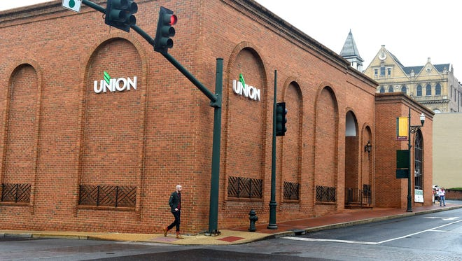 A man walks alongside the Union Bank building located at West Johnson and South Augusta streets in downtown Staunton on Friday, August, 7, 2015.