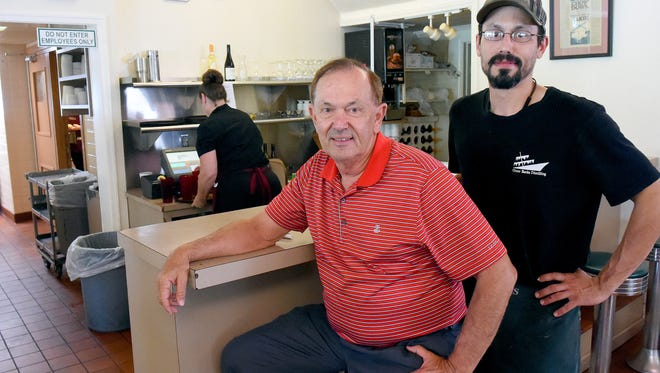 Mildred Rowe's son Mike DiGrassie and grandson Aaron DiGrassie are photographed where she would sit while running Mrs. Rowe's Family Restaurant, which she started 70 years ago. The pair help maintain the family-run restaurant. They are photographed on Thursday, June 22, 2017.