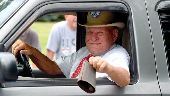 Frank Nolen rings a cowbell as he drives a truck pulling a float during the parade. America's Birthday Celebration held its annual parade in Gypsy Hill on Tuesday, July 4, 2017.