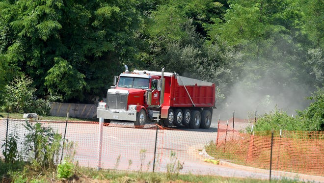 A dump truck departs the construction site for a future Loves Travel Center being built adjacent to the Pilot Travel Center off U.S. 11 near Interstate 81 in Greenville on Monday, July 17, 2017.