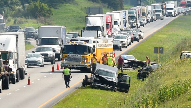 A wreck on Interstate 81 near the Interstate 64 interchange snarls traffic as firefighters with Company 10 remain on the scene on July 17, 2015.