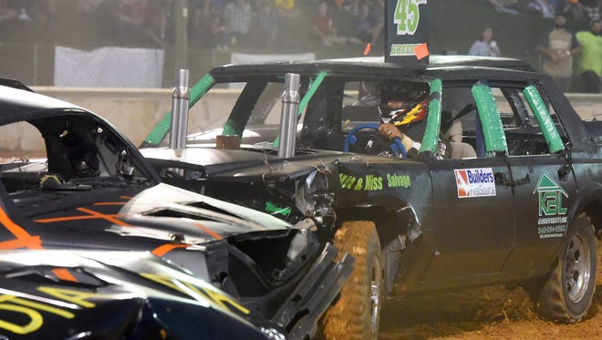 John Breeden of New Hope rams an opponent with his car. He competes in the stock car division of the demolition derby at the Augusta County Fair  on August 3, 2017.
