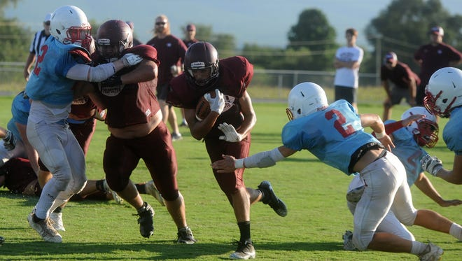 Stuarts Draft's Xzavier Gunn breaks through a hole during his team's scrimmage with Alleghany Friday, Aug. 18.