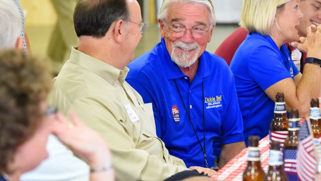Del. Dickie Bell, R-Staunton, shares conversation with others seated at his table. The Greater Augusta Regional Chamber of Commerce hosted an event allowing people to mingle and dine with elected officials, called Pig PickingÕ & PolitickinÕ, at Augusta Expo on Monday, August 22, 2017.