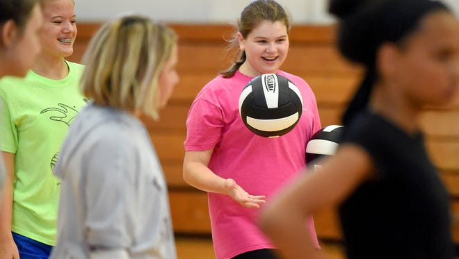 Seventh-grader Ellie Lockridge tosses one of the two balls she carries up and down during team practice at Shelburne Middle School on Tuesday, Aug. 29, 2017.