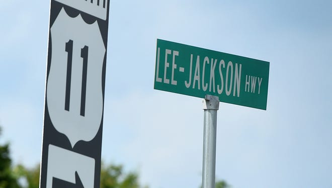 "A Lee-Jackson Highway street sign at US 11 and Frontier Drive names the route after Confederate generals Robert E. Lee and Thomas ""Stonewall"" Jackson."