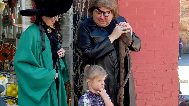 "Alastor ""Mad Eye"" Moody looks down at a young girl as he stands next to Professor McGonagall during the Queen City Mischief & Magic festival in downtown Staunton on Saturday, Sept. 23, 2017. The three-day festival celebrating Harry Potter ends Sunday, Sept. 24, 2017."