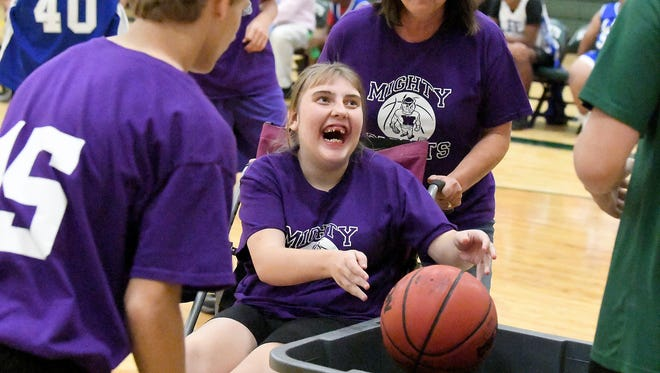 Waynesboro's Ashlen Lowery shoots into an alternate basket from her wheelchair during one of two Unified Basketball finale games played in Fishersville on Monday, Oct. 16, 2017.