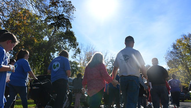 Participants walk three laps together around Gypsy Hill Park as part of the third annual Greater Augusta Out of the Darkness Walk on Saturday, Oct. 21, 2017. The event brought together people affected by suicide and promoted awareness to suicide prevention.