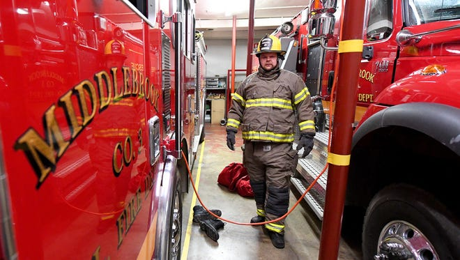 Middlebrook volunteer firefighter Frank Dull says it takes about a minute to suit up in his firefighting gear, minus his air pack.
