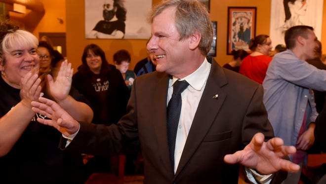 York city mayor-elect Michael Helfrich tries to temper his supporters at the Holy Hound Taproom before the official announcement of his victory over C. Kim Bracey on Tuesday, Nov. 7, 2017.