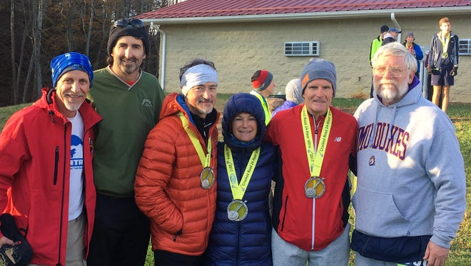 These six local residents combined for 464 individual miles in the Crooked Road 24-Hour Ultra race on November 18-19. From left, Bill Gentry, Robert Weller, Kerry Alexander, Patsy Alexander, Gary Michael and Ron Hartlaub.