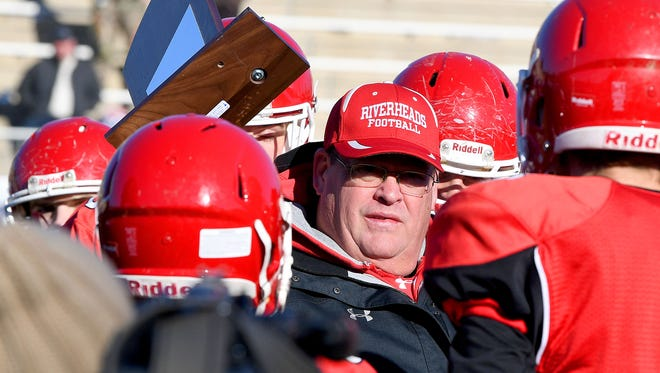 Riverheads' head coach Robert Casto presents the championship trophy to his players after they defeat Chilhowie, 42-0, to win the VHSL Class 1 state championship in Salem on Sunday, Dec. 10, 2017.