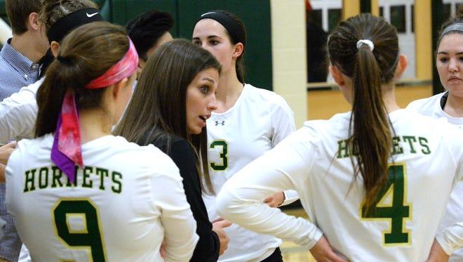 Wilson Memorial's Lauren Grove talks to her team during a regional volleyball game.