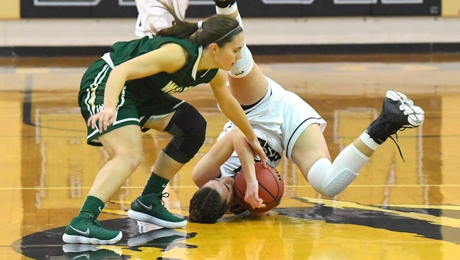 Wilson Memorial's Sam Kershner battles for a loose ball as Buffalo Gap's Leah Calhoun tumbles upside down while still trying to take control of the ball during a basketball game played in Swoope on Friday, January 5, 2018.
