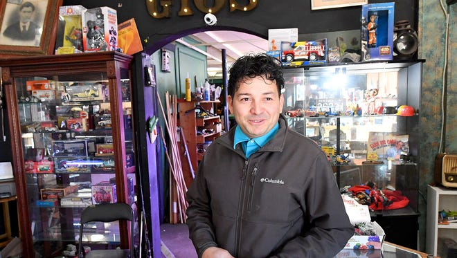 Gio Castro Hernandez stands inside a business he owns in Waynesboro, named Gio's Treasures. He left El Salvador at age 13 and crossed the border into the United States. Also owner of Little Gio's food truck, Castro Hernandez may be forced to leave the U.S. and return to his home country by September 2019.