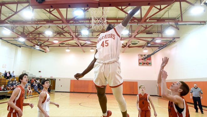Jarace Walker, 14, soars above his teammates at Susquehannock and ninth grade opponents of Dover High School during a recent game in the auxiliary gym of Susquehannock high school. Colleges are reaching out already to the eighth grade basketball player, with recruiting letters coming from Arizona and Syracuse