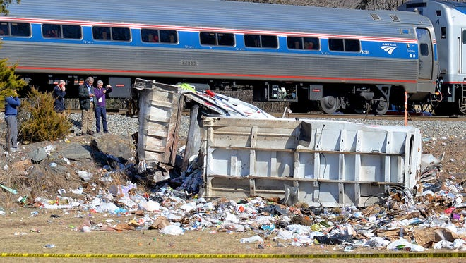 The Amtrak train with the garbage truck it collided with in Crozet on Wednesday. The train was transporting GOP lawmakers to their retreat in West Virginia.