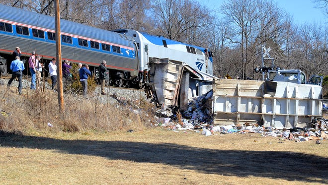 The rear engine of the Amtrak train is visible past the garbage truck the front engine of the train collided with in Crozet on Wednesday. The train was transporting GOP lawmakers to their retreat in West Virginia.