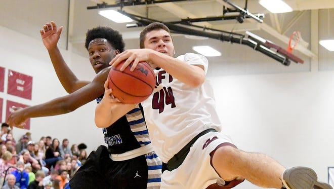 Stuarts Draft's Tyler Goodwin comes away with the rebound next to Robert E. Lee's Blaize Velvin during a basketball game played in Stuarts Draft on Tuesday, Feb. 6, 2018.